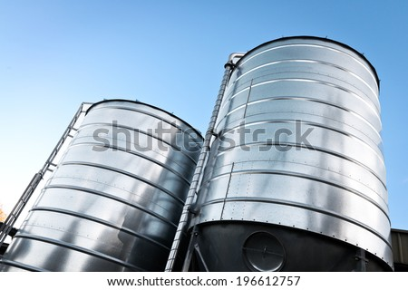two large grain silos - stock photo