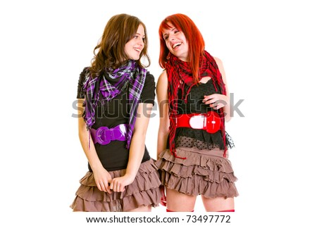 Two laughihg young girlfriends looking on each other isolated on white - stock photo