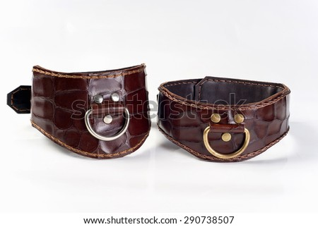Two Leather brown fetish collars on a white background - stock photo
