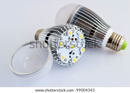 two LED light bulbs with 1 Watts SMD chips in the foreground without cover glass - stock photo