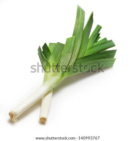 two leeks isolated on white background with shadow.  - stock photo