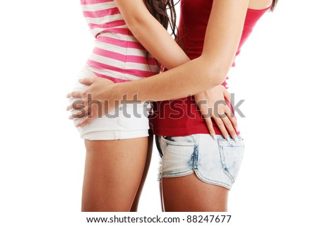 Two lesbian women in short isolated on white background - stock photo