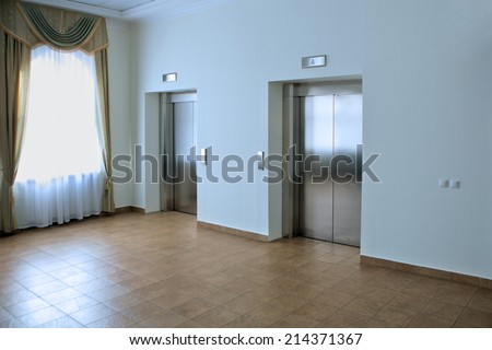 Two lifts in a hotel hall. Modern design interior - stock photo