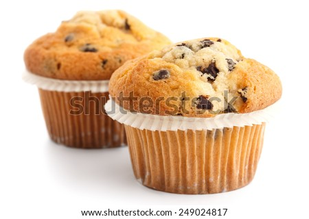 Two light chocolate chip muffins in wax liner on white. - stock photo