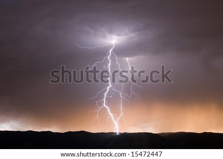 Two Lightning Bolts at Dusk - stock photo