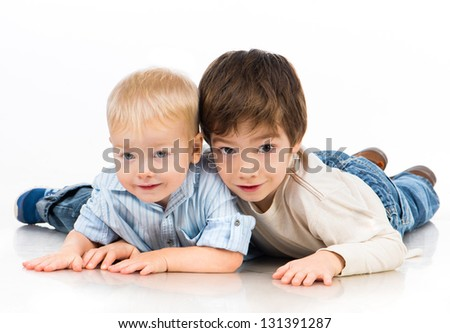 Two little boys (brothers) isolated on white background - stock photo