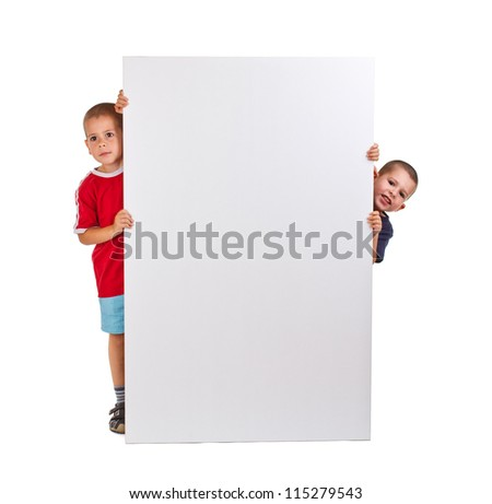 Two little boys look outs from the billboard - stock photo