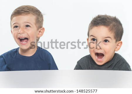 Two little child screaming with joy - stock photo