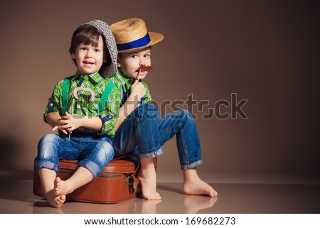 Two little cute boy brothers - stock photo