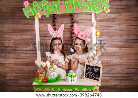 Two little girl with bunny ears enjoying the Easter holidays - stock photo