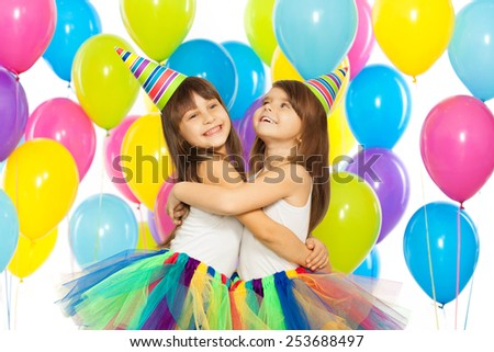 Two little girls at birthday party. Holidays concept. - stock photo