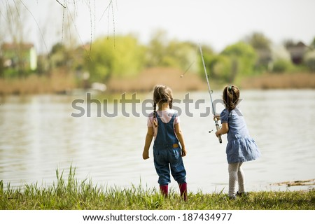 Two little girls at fishing - stock photo