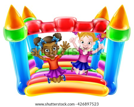 Two little girls having fun jumping on a bouncy castle - stock photo