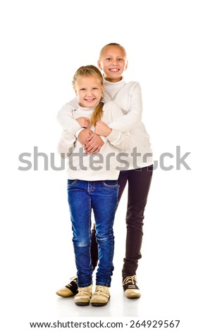 two little girls isolated on a white background - stock photo