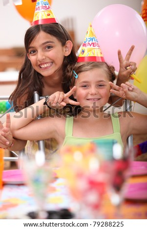 two little girls on a birthday party - stock photo