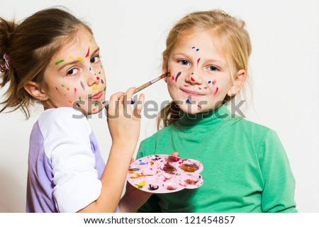 Two little girls painting and have a fun - stock photo