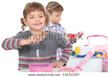 two little girls playing - stock photo