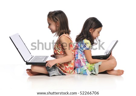 Two little girls with laptop computers isolated on a white background - stock photo