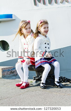two little happy girls in port - stock photo