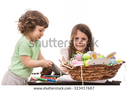 Two little kids at kindergarten isolated on white background - stock photo
