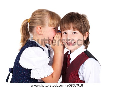 Two little kids telling secrets isolated on white background - stock photo
