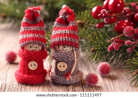 Two little santa decoration on wooden background - stock photo