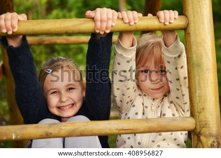 two little sister playing outdoor - stock photo