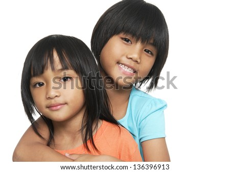 Two little sisters - stock photo