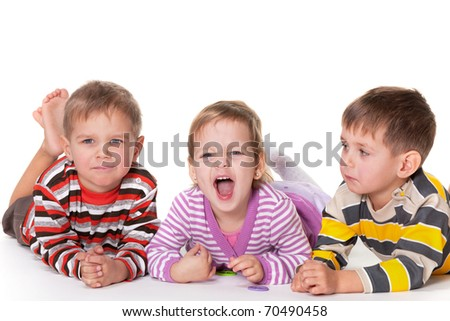 Two little twins are surprised why their girl friend is shouting; isolated on the white background - stock photo