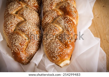 Two loaves of seeded challah for Shabbat - stock photo