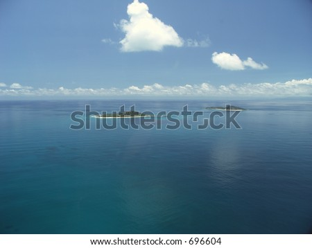 two lonely islands in the indian ocean near praslin seychelles - stock photo