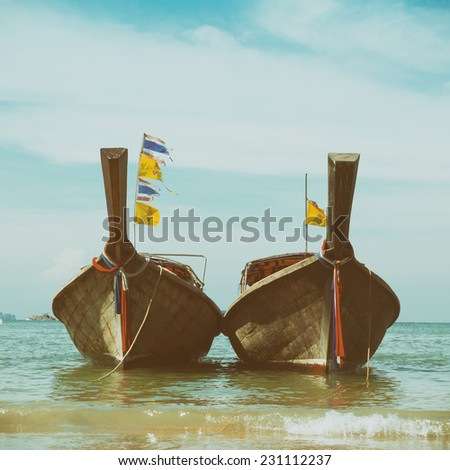 Two longtail wooden boats with national and royal Thailand flags , vintage stylized - stock photo