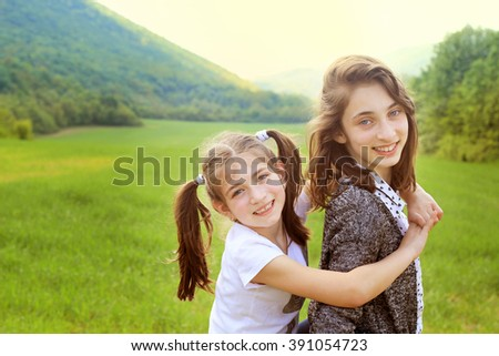 Two lovely girls are sisters of different age .Concept Sisters T - stock photo