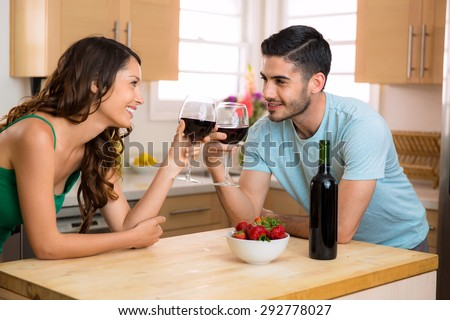 Two lovers stare into each others eyes on a date foreplay with conversation and a romantic mood with wine - stock photo