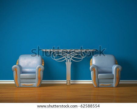 Two luxurious chairs with metallic console in minimalist interior - stock photo