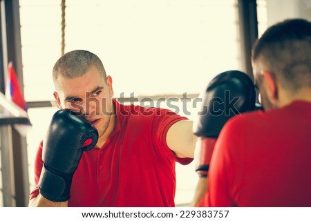 Two Male Boxers Sparring - stock photo