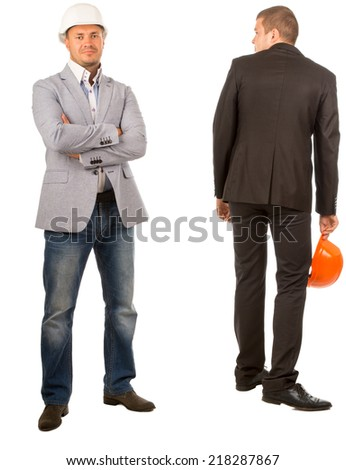 Two Male Middle Age Engineers, One is Looking at Camera While the Other is Facing Backward, on White Background - stock photo