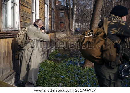 Two males aiming to shoot the robber - stock photo