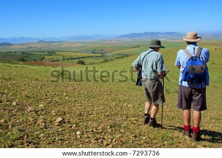 Two man, father and son - and mountain rural landscape with lakes is background. Shot in Kasteelberg Mountains nature reserve, near Riebeek, Western Cape, South Africa. - stock photo
