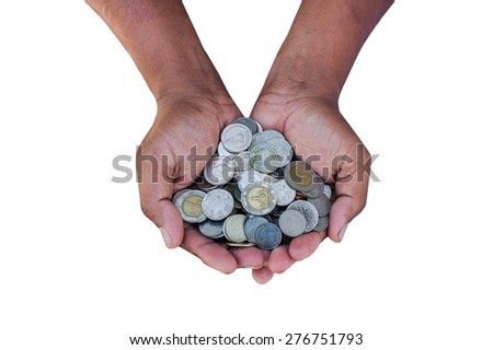 Two man hands holding a pile of coins. Viewed from top  - stock photo