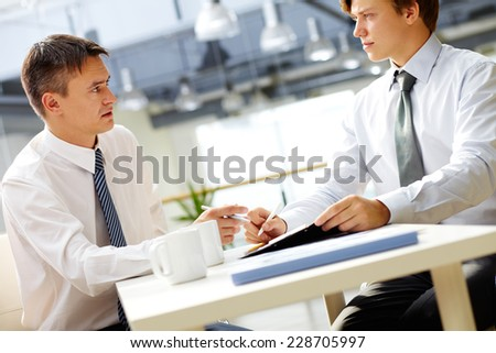 Two managers planning work in office - stock photo