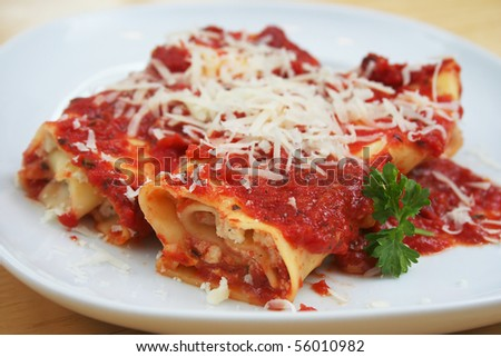 Two Manicotti on a White Plate - stock photo