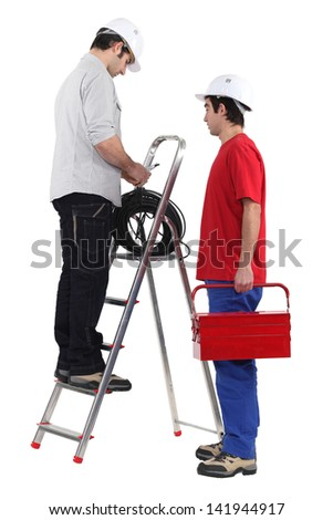 Two manual workers - stock photo