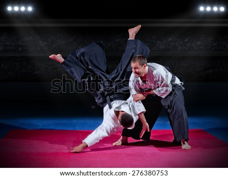 Two martial arts fighters at sports hall - stock photo