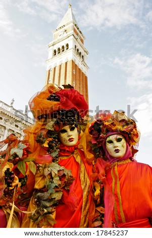 Two  mask in San marco's square, Venice, Italy. - stock photo