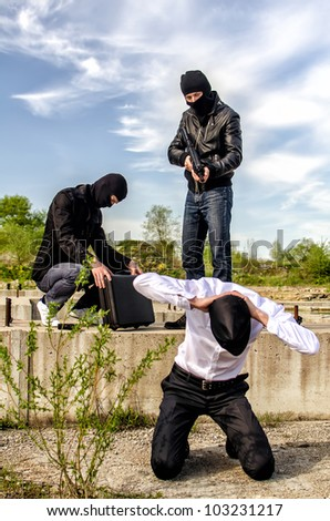 Two masked gunman trying to kill businessman - stock photo
