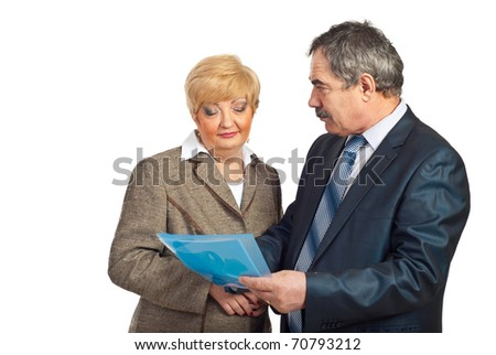 Two mature business people discuss contract isolated on white background - stock photo