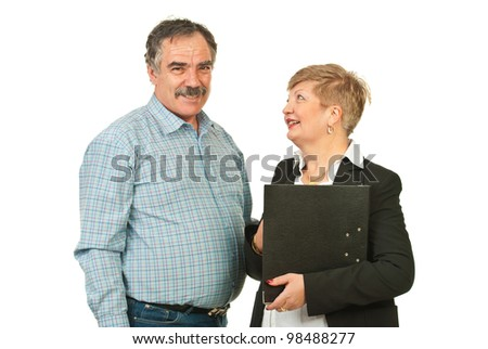 Two mature business people having conversation and laughing together isolated on white background - stock photo
