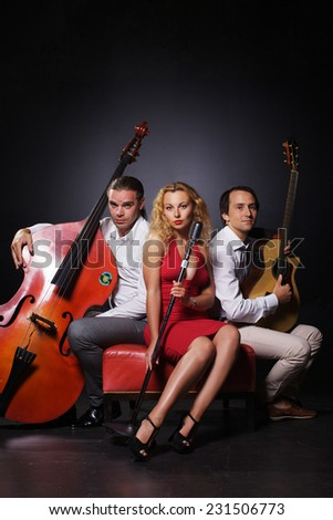 Two men and woman are playing jazz - stock photo