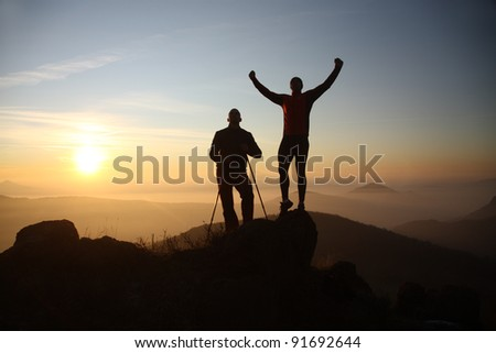 Two men at  a peak - stock photo